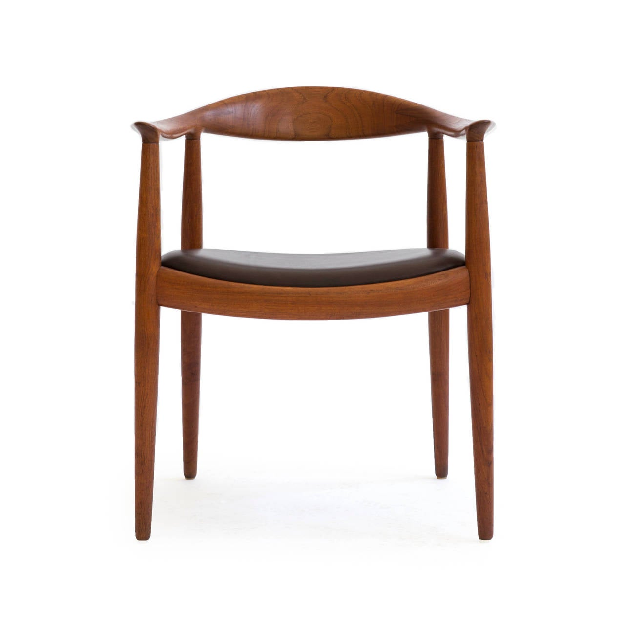 Hans J. Wegner 'The chair' in teak and dark brown leather seat. 