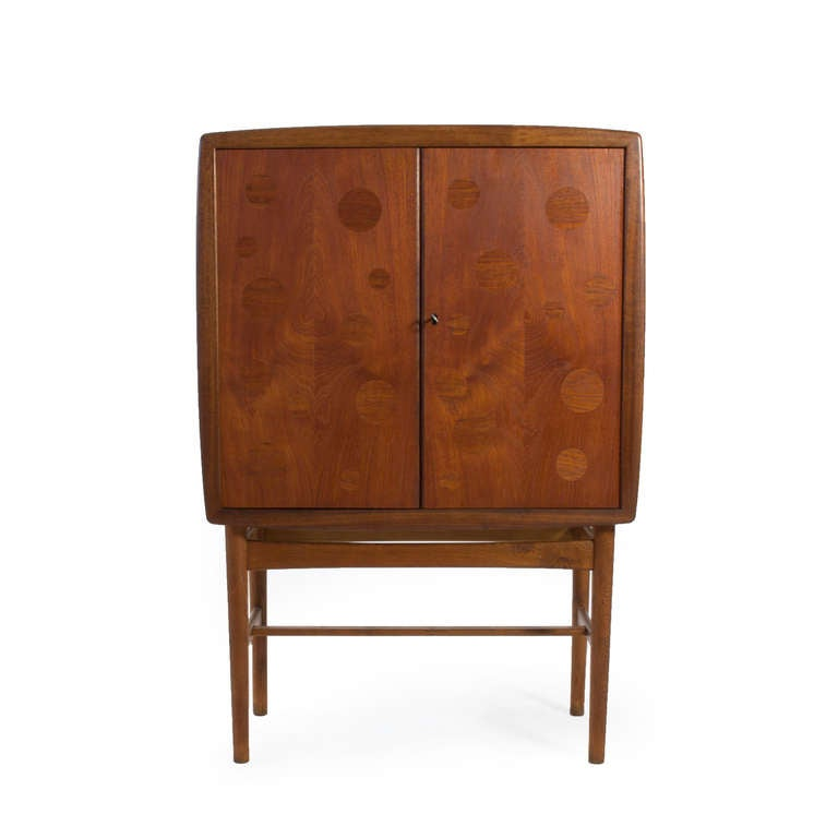 Tove & Edvard Kind Larsen bar cabinet.   Teak doors with circular oak inlays, frame of patinated oak.  Manufactured by cabinet maker Torald Madsen, Denmark.   Inside with bar interior.  A beautiful piece in stunning original condition.
