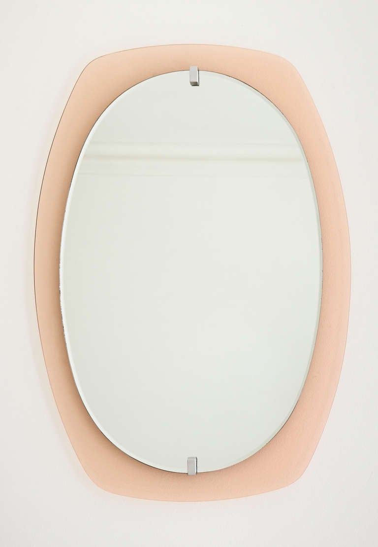 Vintage mirror with pink glass frame.