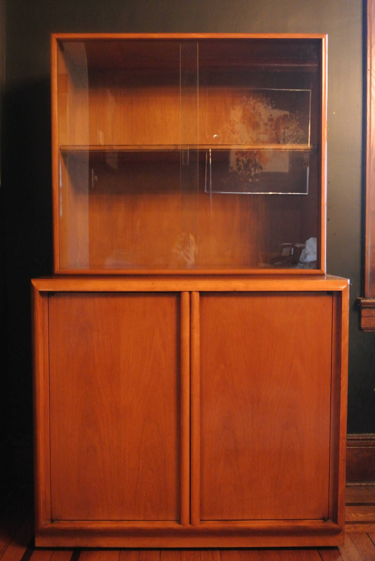Birch China Cabinet by T.H. Robsjohn Gibbings for Widdicomb Furniture Co. Straight lines w. two sliding glass panes w. beveled handles.