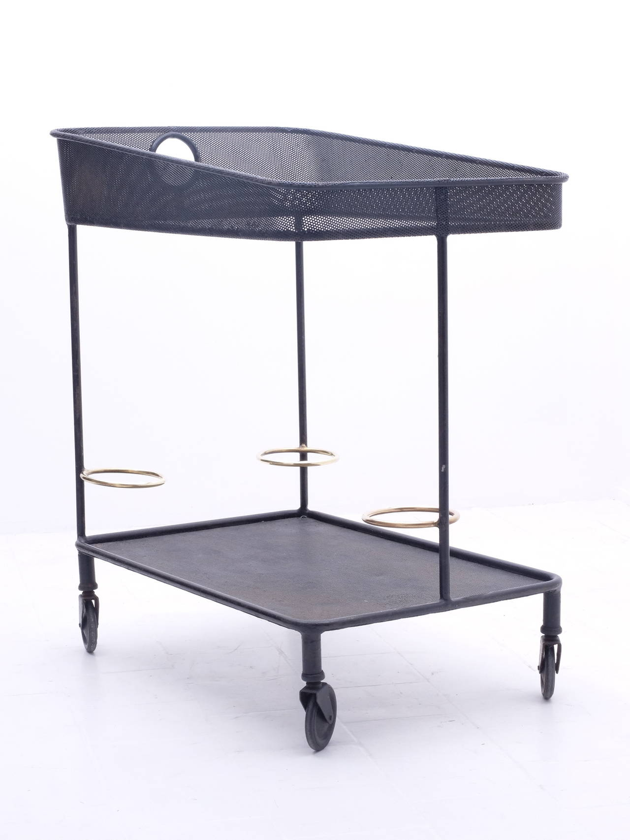 Serving table in perforated sheet metal or rigitule byMathieu Matégot by Ateliers Mathieu Mategot, France. Rigitule glass and brass. Venise model, 1953. Documented and referenced in MathieuMatégot by Jousse Entreprise. Totally untouched and in