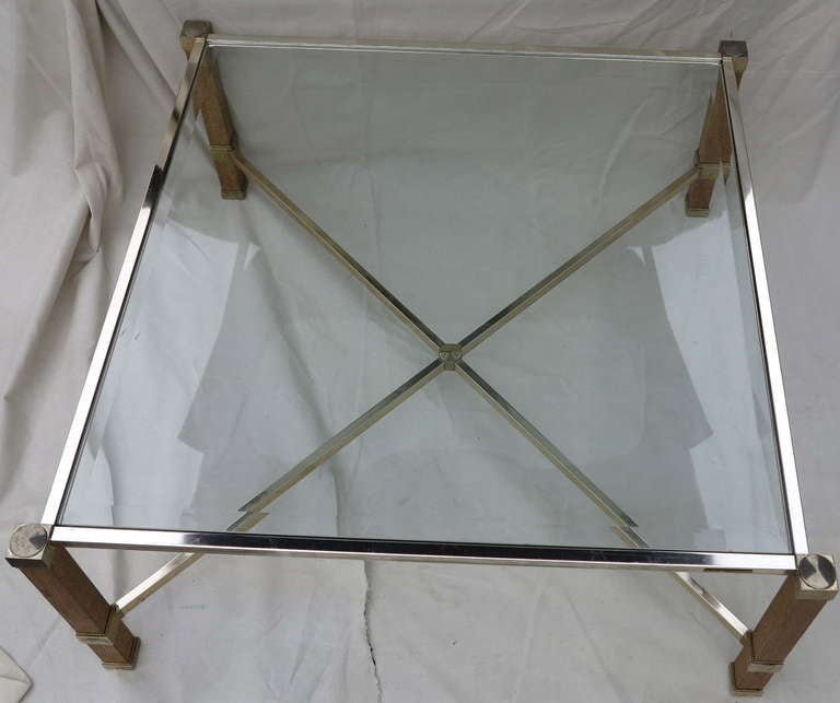 Oak coffee table with brass frame and x-stretcher, and glass top. Signed Pierre Vandel.