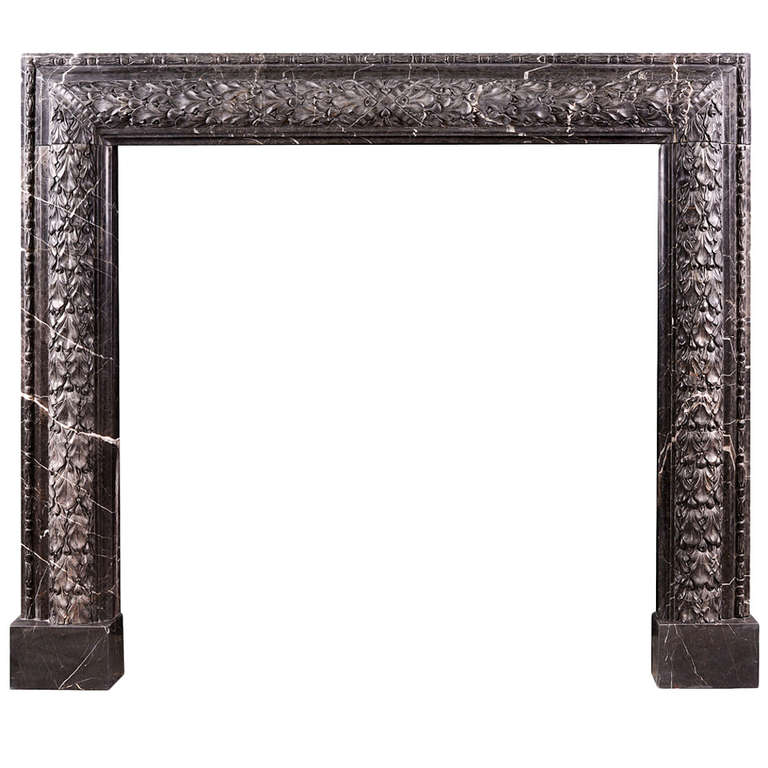 Elegant Carved Bolection Mantel in Nero Marquina Marble For Sale