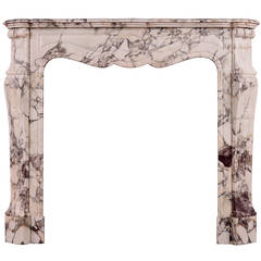 For Sale on 1stdibs - This fireplace mantle is formed of a composite faux-marble exterior
