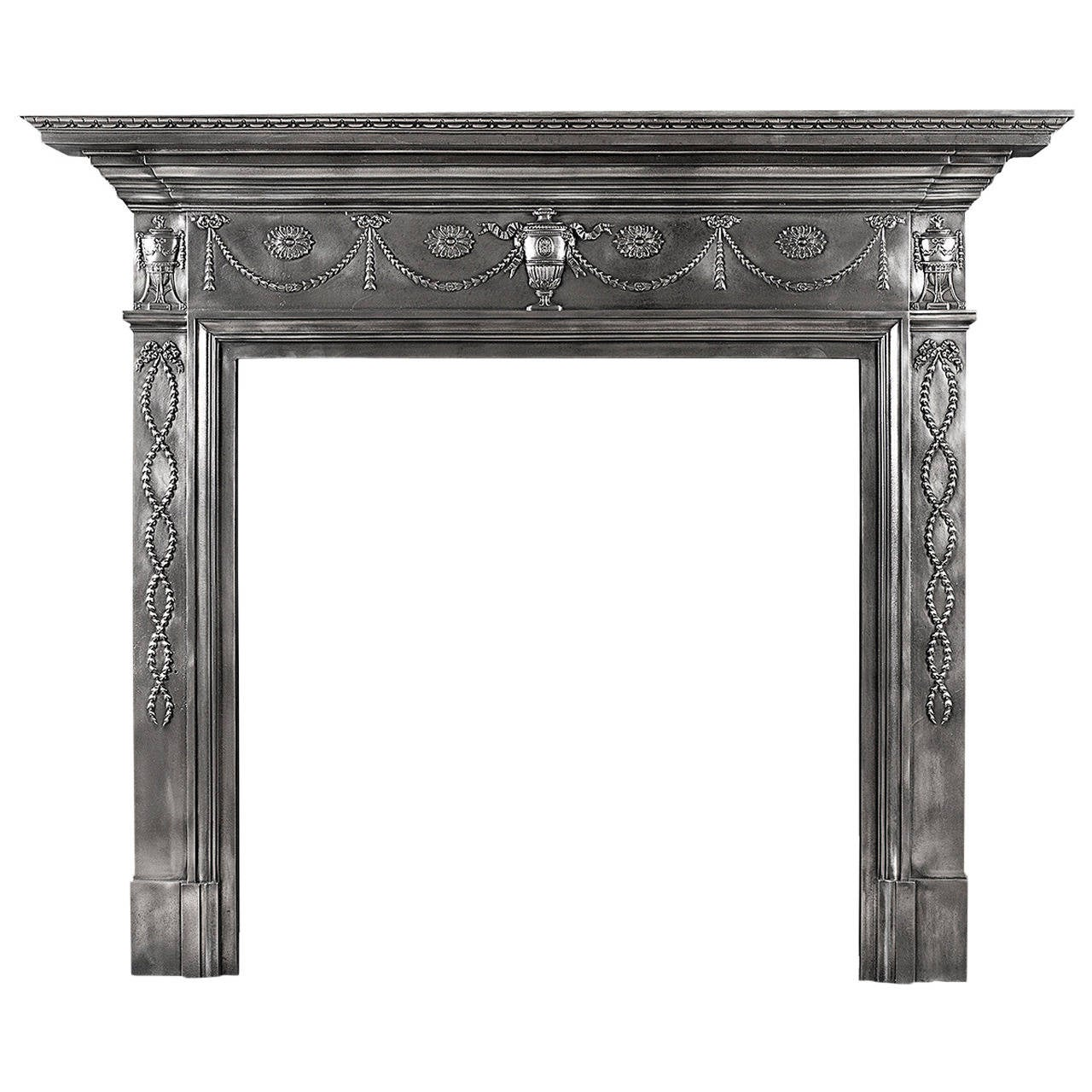 a 19th century polished cast iron fireplace mantel in the adam