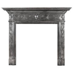 A 19th century polished cast iron fireplace mantel in the Adam style