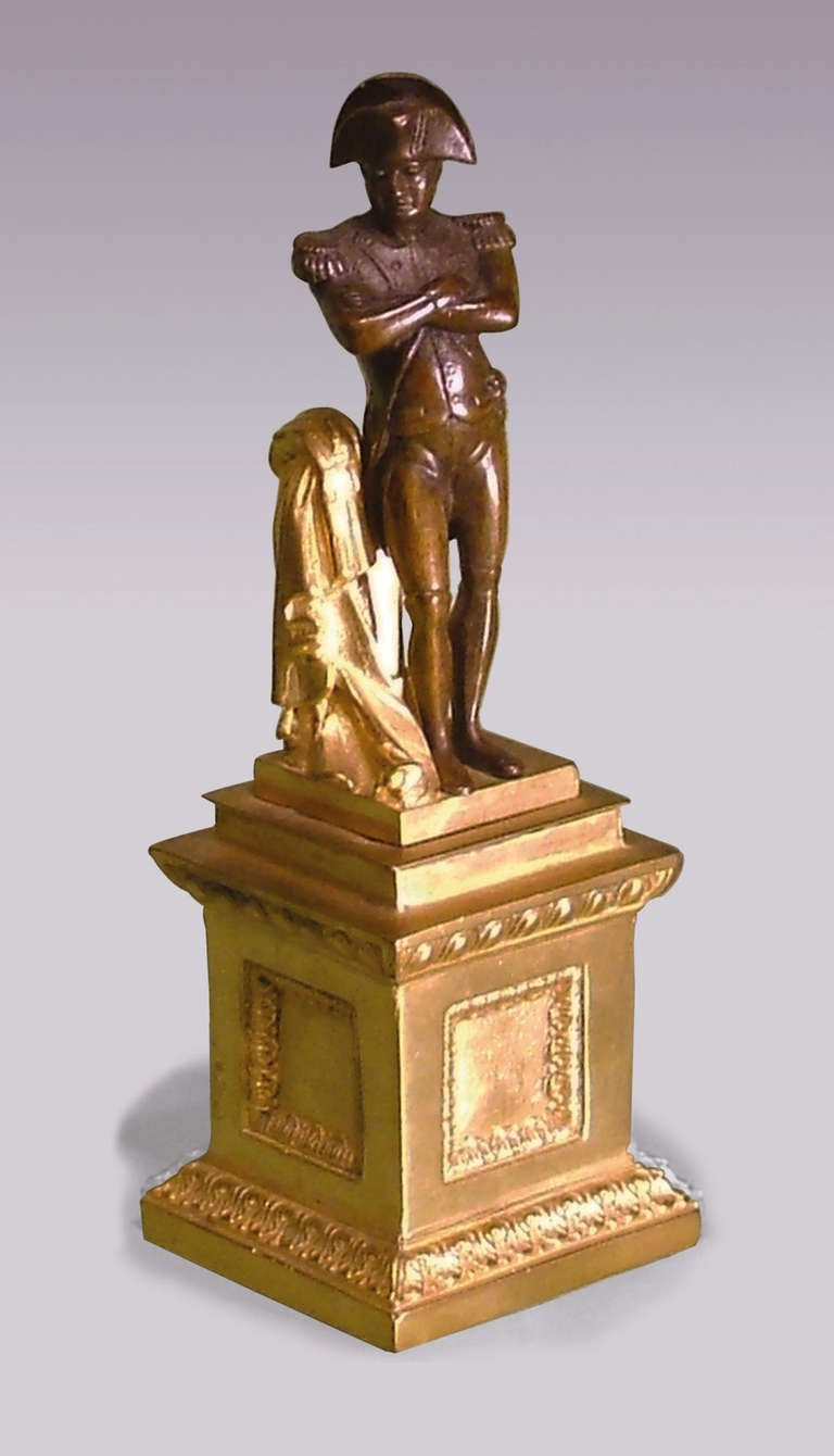 A mid-19th century well-cast contrasting bronze and ormolu statue of Napoleon, in his typical 'arms folded' pose, standing arrogantly on an ormolu stepped platform, ending on acanthus decorated and panelled plinth base. A great addition to your