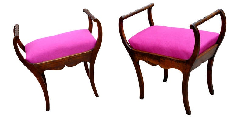 Set of two Art Nouveau stools with hot lipstick pink seats.
