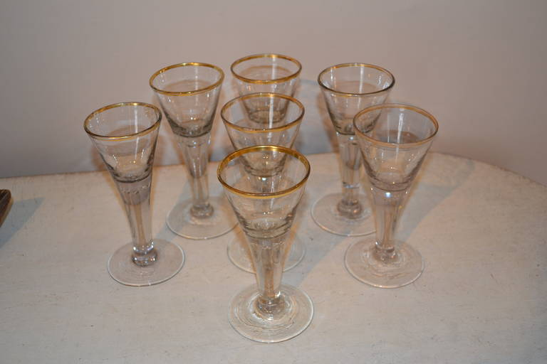 Set of seven very nice gold rimmed and handblown glasses.
