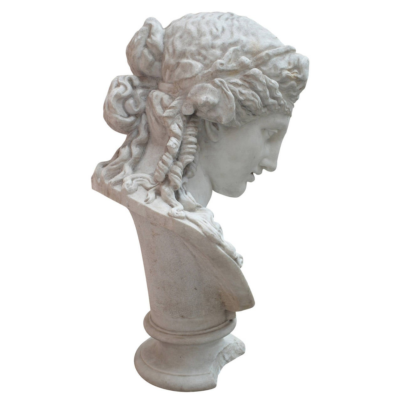 The bust stands on a baluster foot. The head seems to be female due to the long curly hair and the elaborate hairstyle. There is no indication of clothing but a single headband holding her hair in place. She looks down and has a very classically