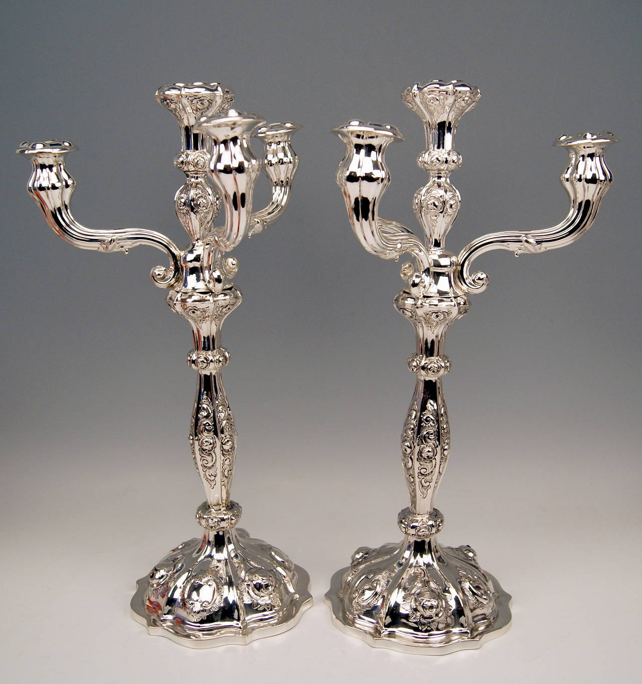 Gorgeous Viennese Silver Pair of Tall Candlesticks of finest manufacturing quality as well as of most elegant appearance. These candlesticks were made during   VIENNESE  LATER  BIEDERMEIER  PERIOD. They are abundantly decorated - made in following