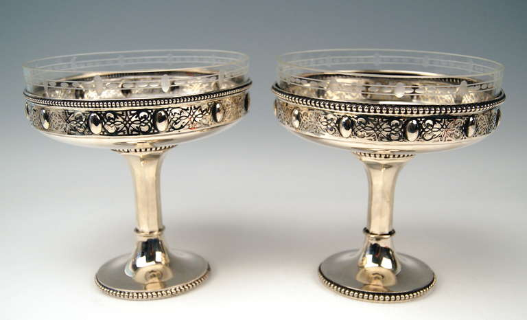 GERMAN PAIR OF SILVER CENTREPIECES WITH ORIGINAL GLASS LINERS  Art Nouveau Period  /  made circa 1900    EXCELLENTLY MADE CENTREPIECES BEING AMAZINGLY SHAPED:    THE BOWLS HAVE EXCELLENTLY WORKED RIMS WITH LATTICED DECORATIONS SHOWING FINEST