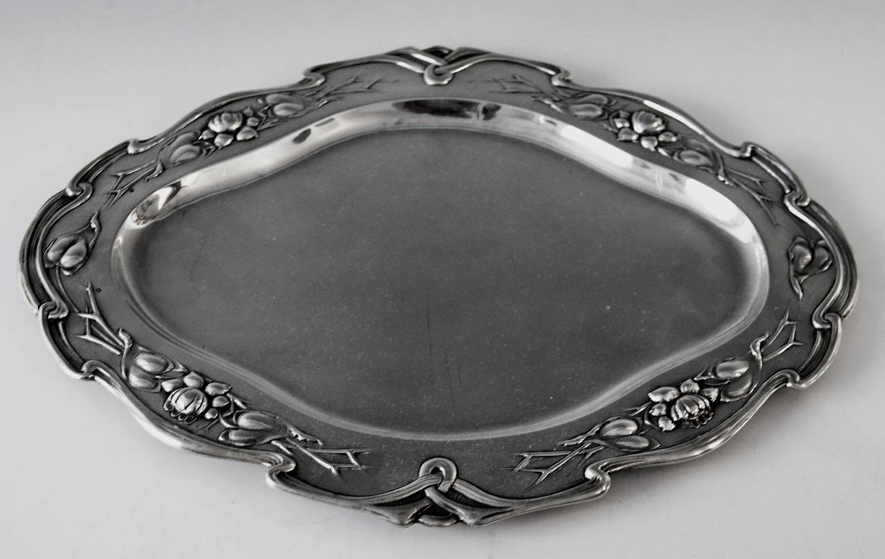 Austrian silver excellent serving platter vienna  art nouveau  /  made circa 1905  excellently made oval silver serving platter of finest quality. the platter's middle area has smooth surface   /   its edge is decorated with finest ornaments: