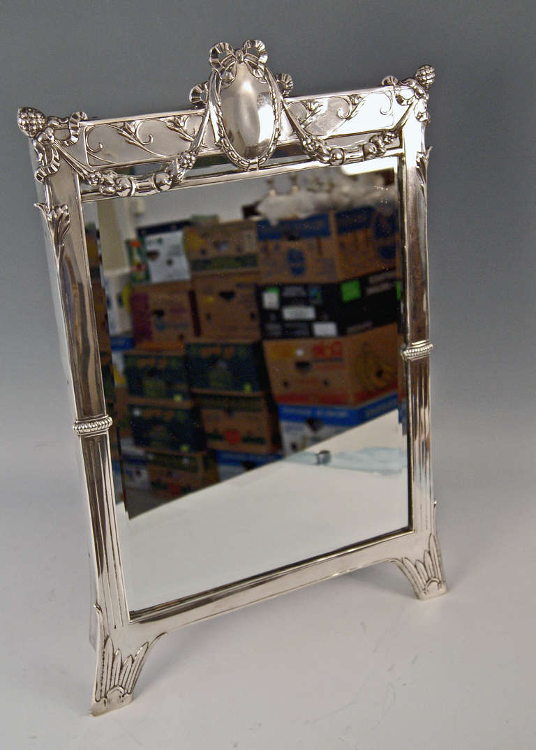 Silver Art Nouveau tall mirror, made by Eduard Friedmann, circa 1905. The mirror is of stunning appearance - it is manufactured in following manner: The item is of rectangular or oblong form type, supported by sustainer attached to mirror's