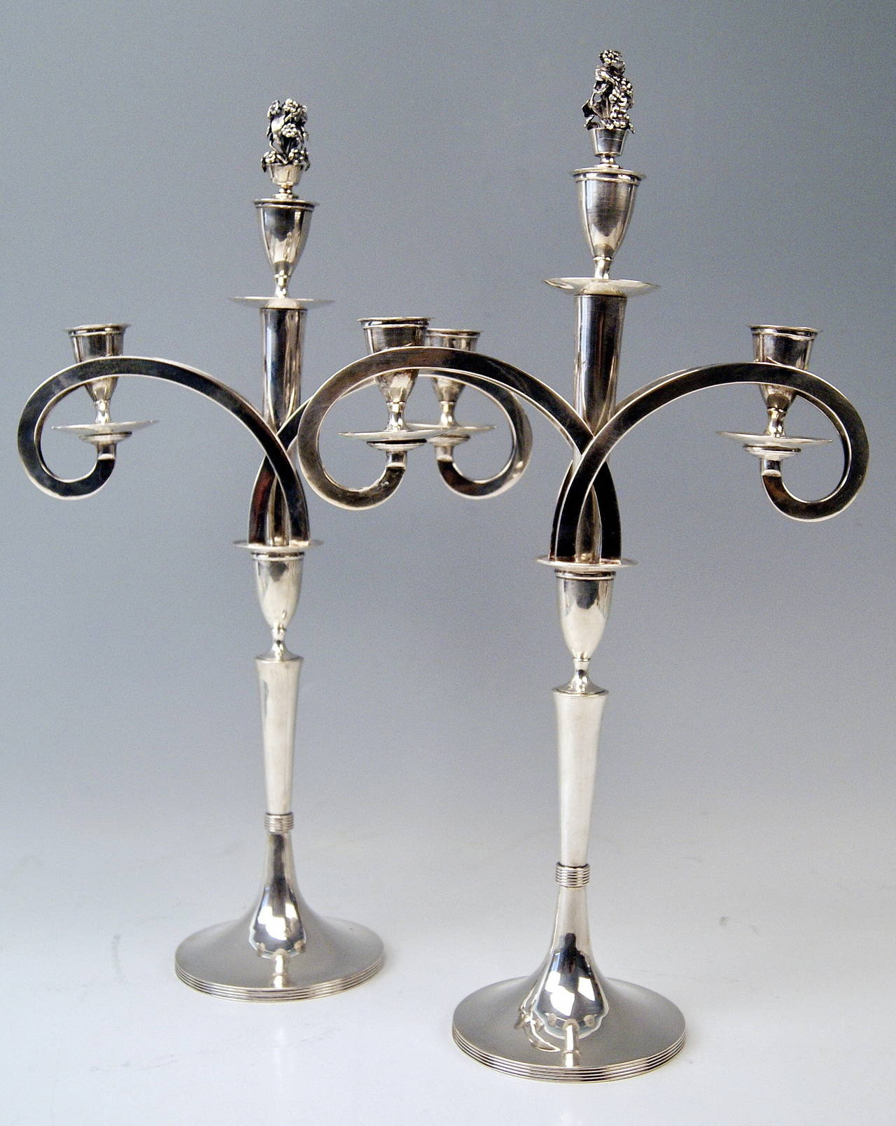 Gorgeous Viennese silver pair of tall candlesticks of finest manufacturing quality as well as of most elegant appearance.
