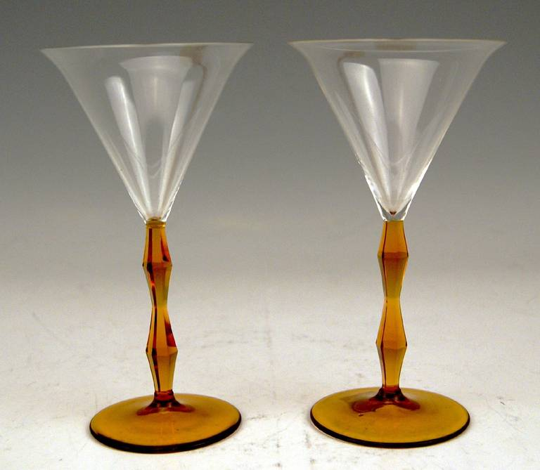 Most elegant Art Deco Set of Two Stalky Liqueur Glasses designed by Josef Hoffmann. The stalks which are facet cut are amber shaded  /  the cups of glasses are made of colorless thin glass. Made circa 1920 by Meyer's nephew, Adolf b. Winterberg  /