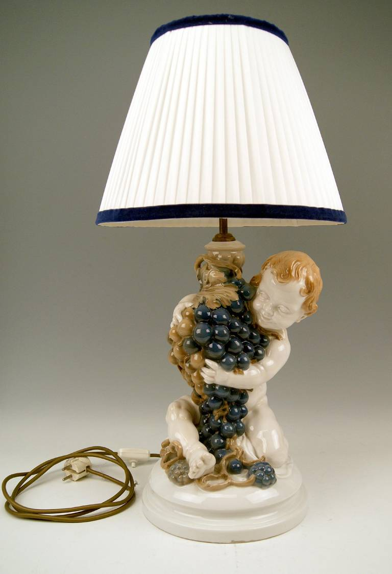 Gorgeous Rosenthal Germany Huge Cherub table lamp modeled by Constantin Holzer-Defanti/model created in year 1919 / manufactured during first quarter of the 20th century: made circa 1920-1925.  The huge lovely cherub's figurine embraces wine grapes