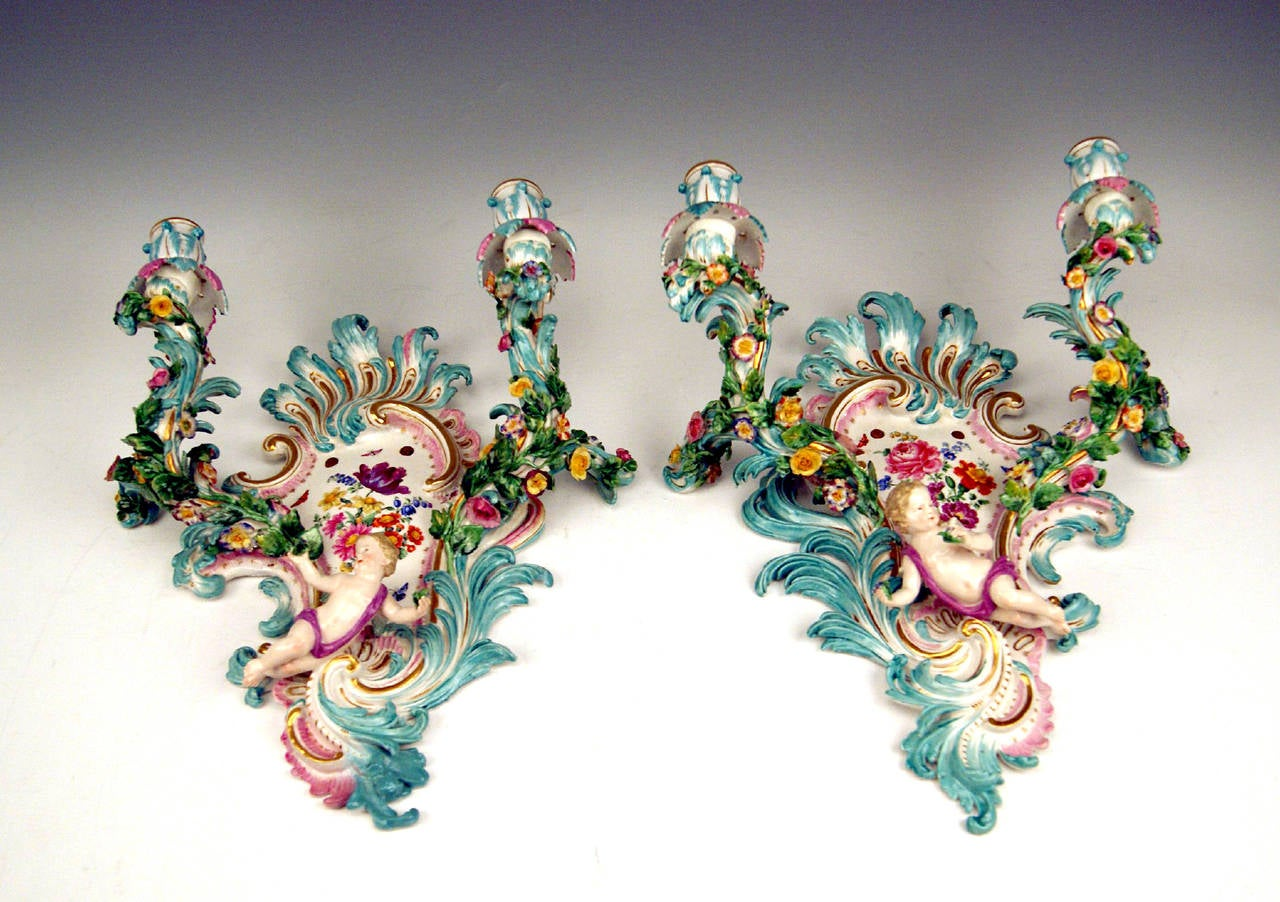 Meissen stunning pair of sconces or two branch candlelights, made circa 1860-1870.   Hallmarked:  Meissen Crossed Sword Mark with Pommels on Hilts of middle of  19th century / FIRST QUALITY  / manufactured, circa 1860-1870.    Model number C 32