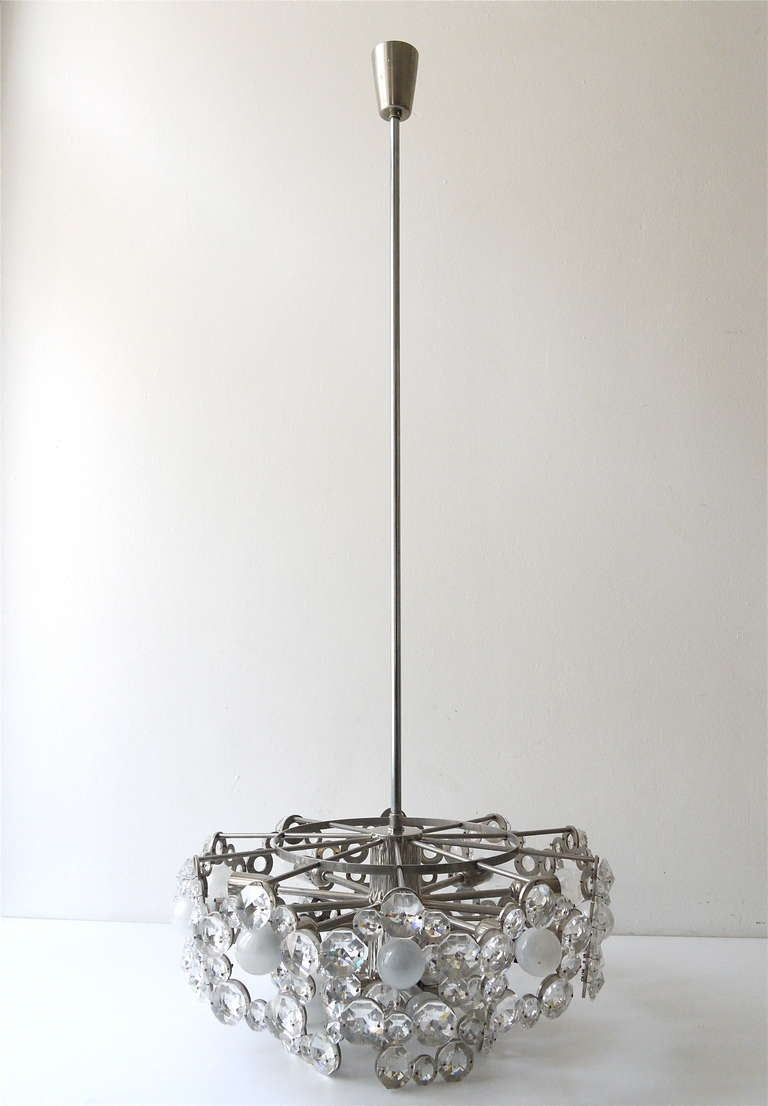 A very exceptional and big crystal chandelier, executed by Lobmeyr Vienna in the the 1960s. Made of nickel-plated metal and full of big, sparkling faceted crystals. Has 15 sockets, diameter 20 inches/50cm, total height incl. rod is 45 inches/115cm,