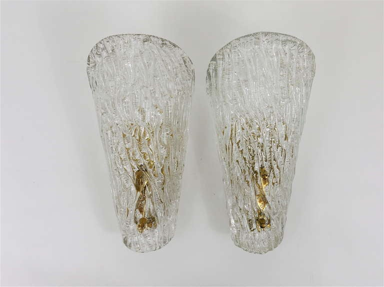 A beautiful pair of brass and glass modernist wall lamps, made by Kalmar Vienna in the 1950s. Very charming sconces, made of solid textured glass on brass bases with nice knobs. In very good condition with patina on the brass. Measure: height 11