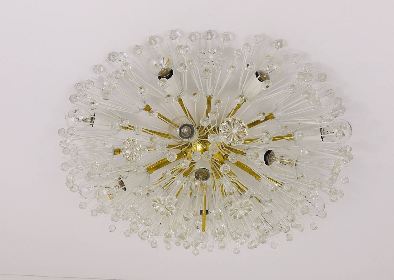 A beautiful and big, hemispheric blowball light, to use as a flush-mount or wall light / sconce. Designed by Emil Stejnar, executed by Rupert Nikoll, Vienna. Made of brass, fully covered with flowers and crystals. Has been carefully restored and is