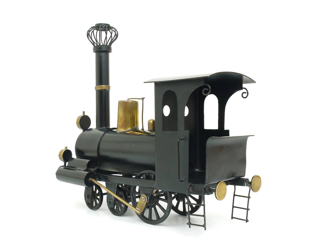 A rare model of a locomotive, handmade of metal and brass. Executed by Werkstatt Hagenauer in the 1920s. Fully marked on its bottom. In excellent condition, nice patina.