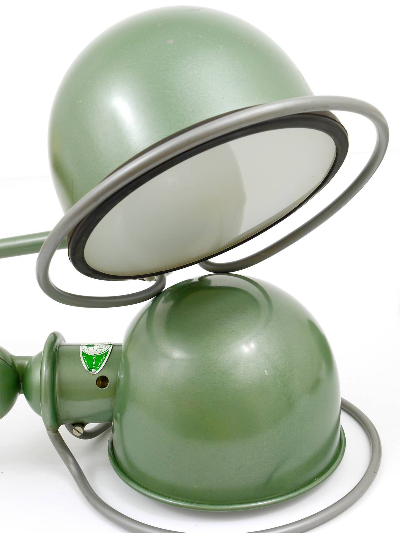 Up to two identical green clamp lamps by Jean Louis Domecq for Jielde Lyon/France. Unrestored vintage originals from the 1950s. They will be delivered with clamp bases, but you can use them also as sconces or mount them directly on the tabletop.