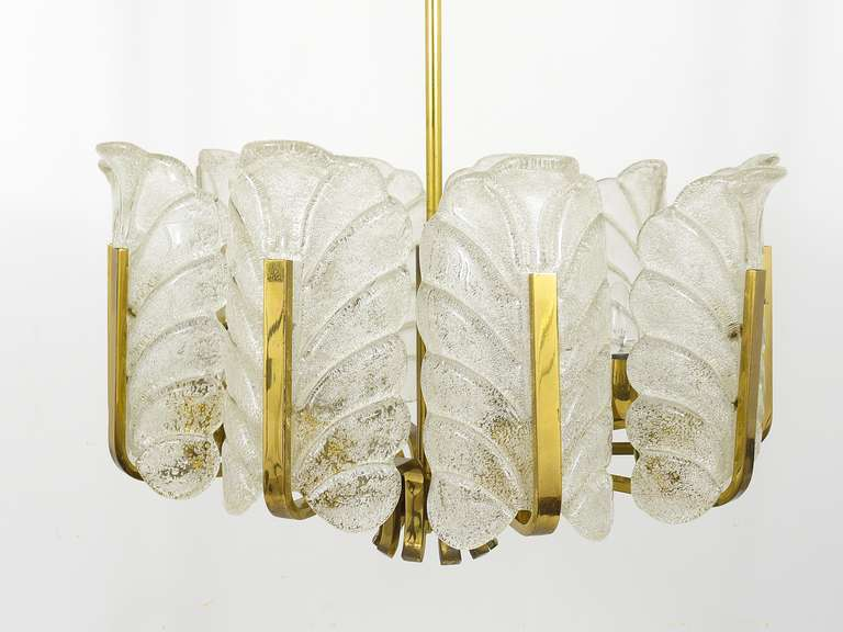 A beautiful modernist brass chandelier with handblown frosted glass leaves, designed by Carl Fagerlund, executed by Orrefors Sweden. Has 10 arms, diameter is 20 in. In good condition with charming patina on the brass, the leaf glasses are free of