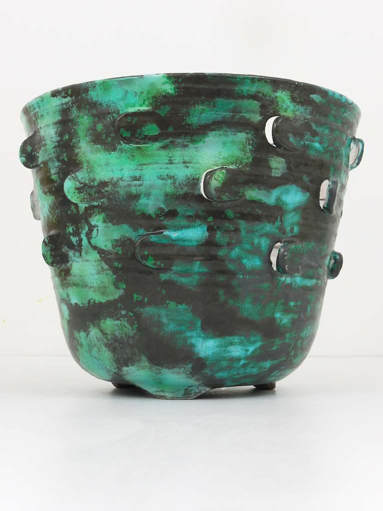 A very beautiful and big Art Nouveau pottery flower pot with green/turquoise/black glaze. Designed by the Vienna Secession artist Michael Powolny in the 1920s. Executed by Wiener Keramik factory. Marked on its underneath. In excellent condition.