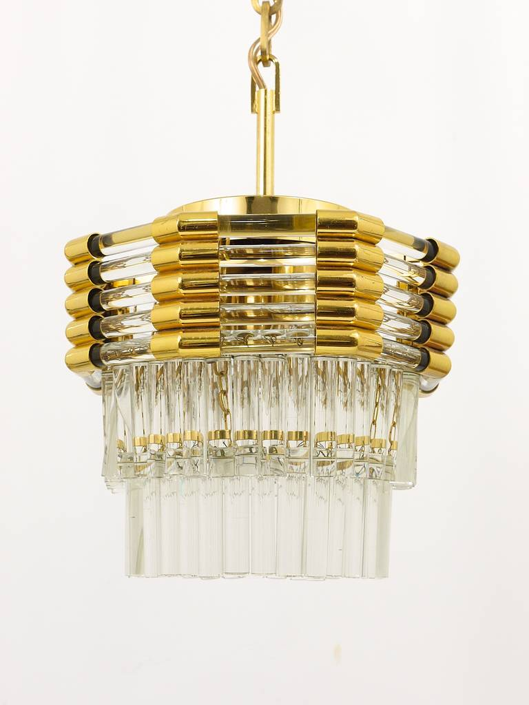 A beautiful Austrian chandelier, gold-plated brass with two layers of nice crystal glass rods, executed by Bakalowits  und Sohne in the 1970s. Has four bulbs. In excellent condition with marginal patina. The chandelier has a diameter of 11 in total