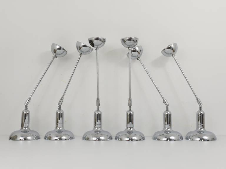 A set of up to six beautiful, identical, chrome-plated pendant lights from the 1970s. Adjustable by an integrated hinge. Made in Italy, in the style of Gino Sarfatti. In excellent condition. Offered as a set of six, but can be sold separately, price