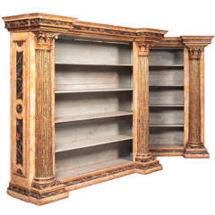 Pair of large Neoclassical style gilt-wood and painted open bookcases