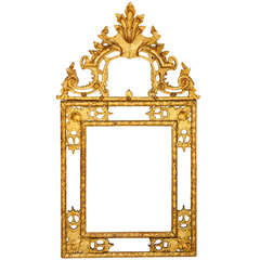 An unusual size Regence gilt-wood mirror, circa 1720-30