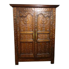 Early 19th Century French Armoire with Folky Elaborate Carvings