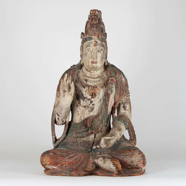Seated Buddha with remnants of polychrome, china.