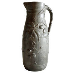 A French beer or water jug with naturalist decoration, Brateau