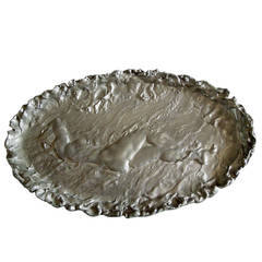 A Large French Oval Pewter Plaque Of A Female Nude, By Jules Desbois.