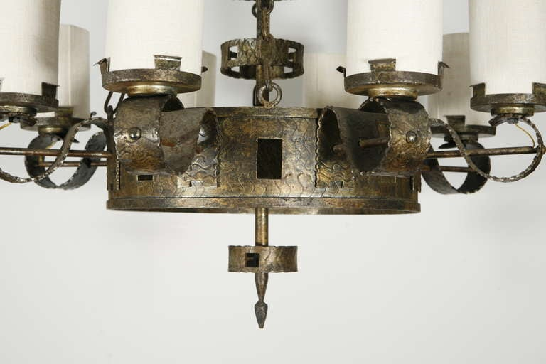 a single iron chandelier with eight shaded lights