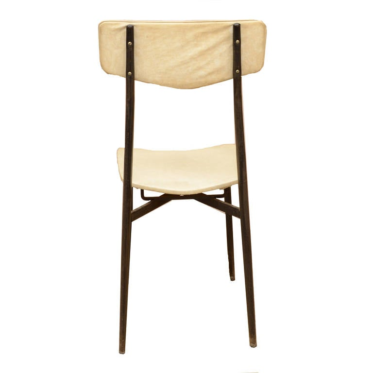 Round table in white laminated wood with six chairs at 1stdibs