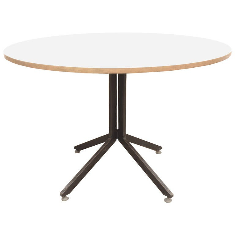 Round table in white laminated wood with six chairs