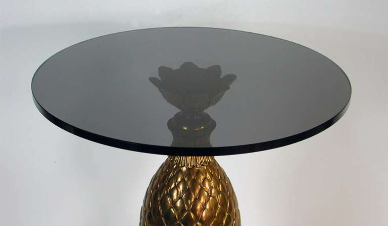 Awesome and unusual bronze pine cone side table with dark grey tinted glass tabletop.