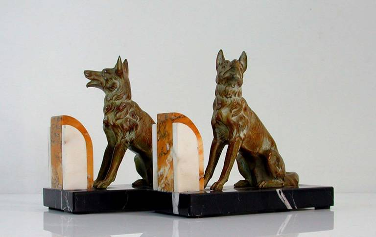 Awesome pair French bookends on three tone marble bases featuring German shepherd dogs.