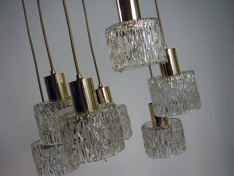 Awesome seven-tier textured glass and brass cascading chandelier by J.T. Kalmar, made in Austria in the early 1960s.