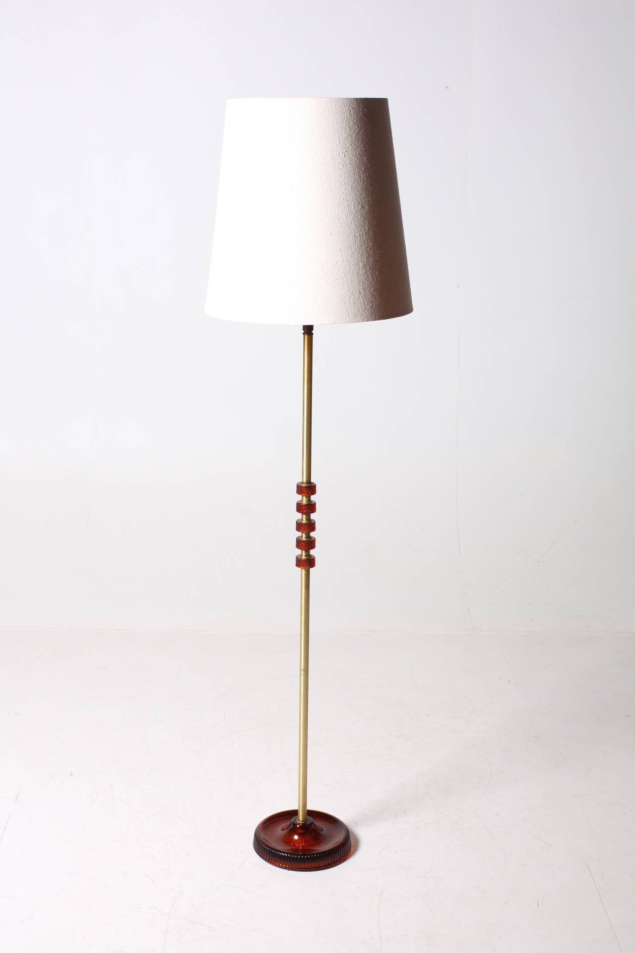 Floor lamp in brass and art glass, adjustable hight . Designed by Carl Fagerlund Made by Orrefors Sweden. 1960,s - Original condition.