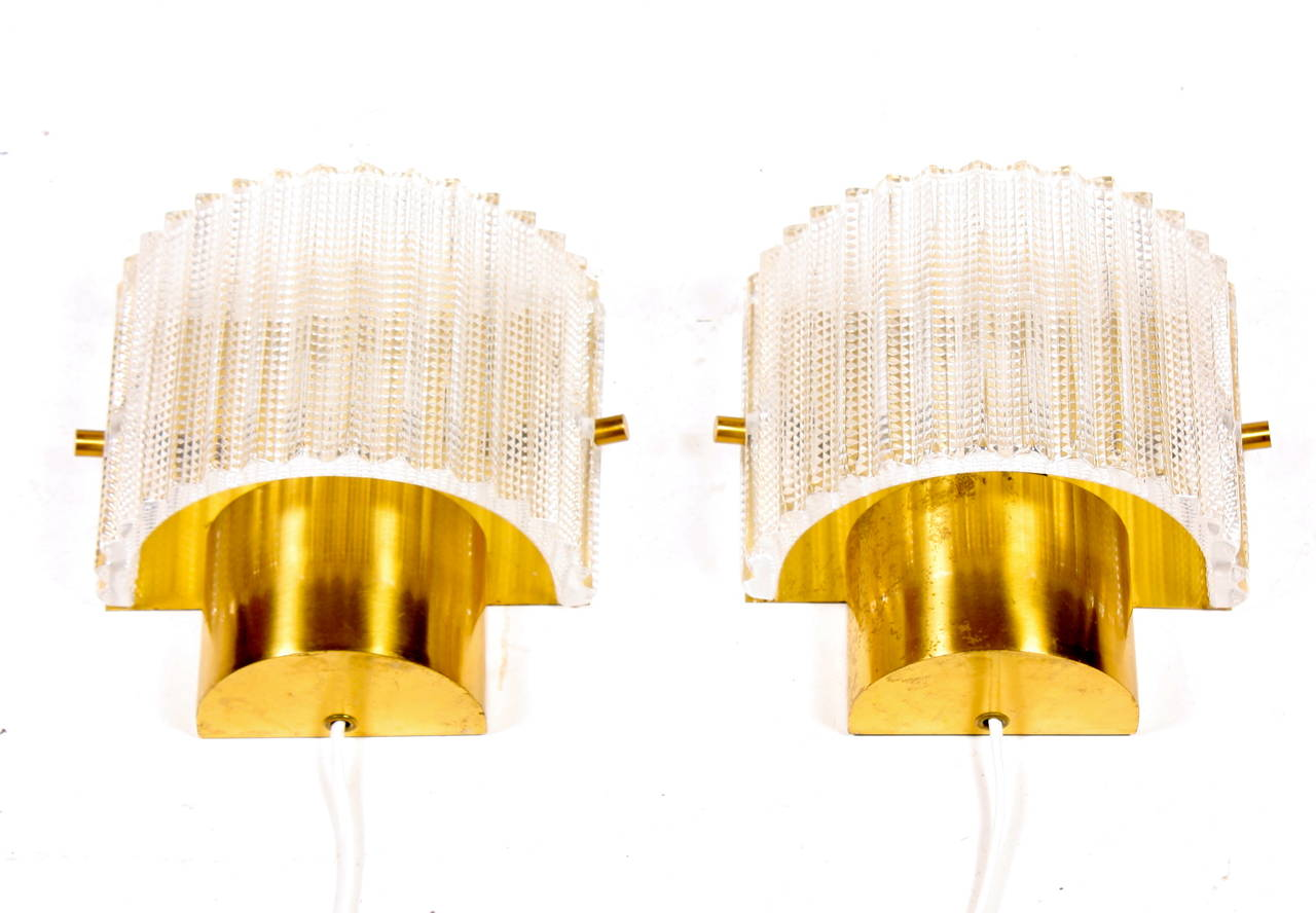 Great looking pair of wall sconces in art glass and brass by LYFA / Orrefors. Made in Denmark in the 1960's. Good condirtion.