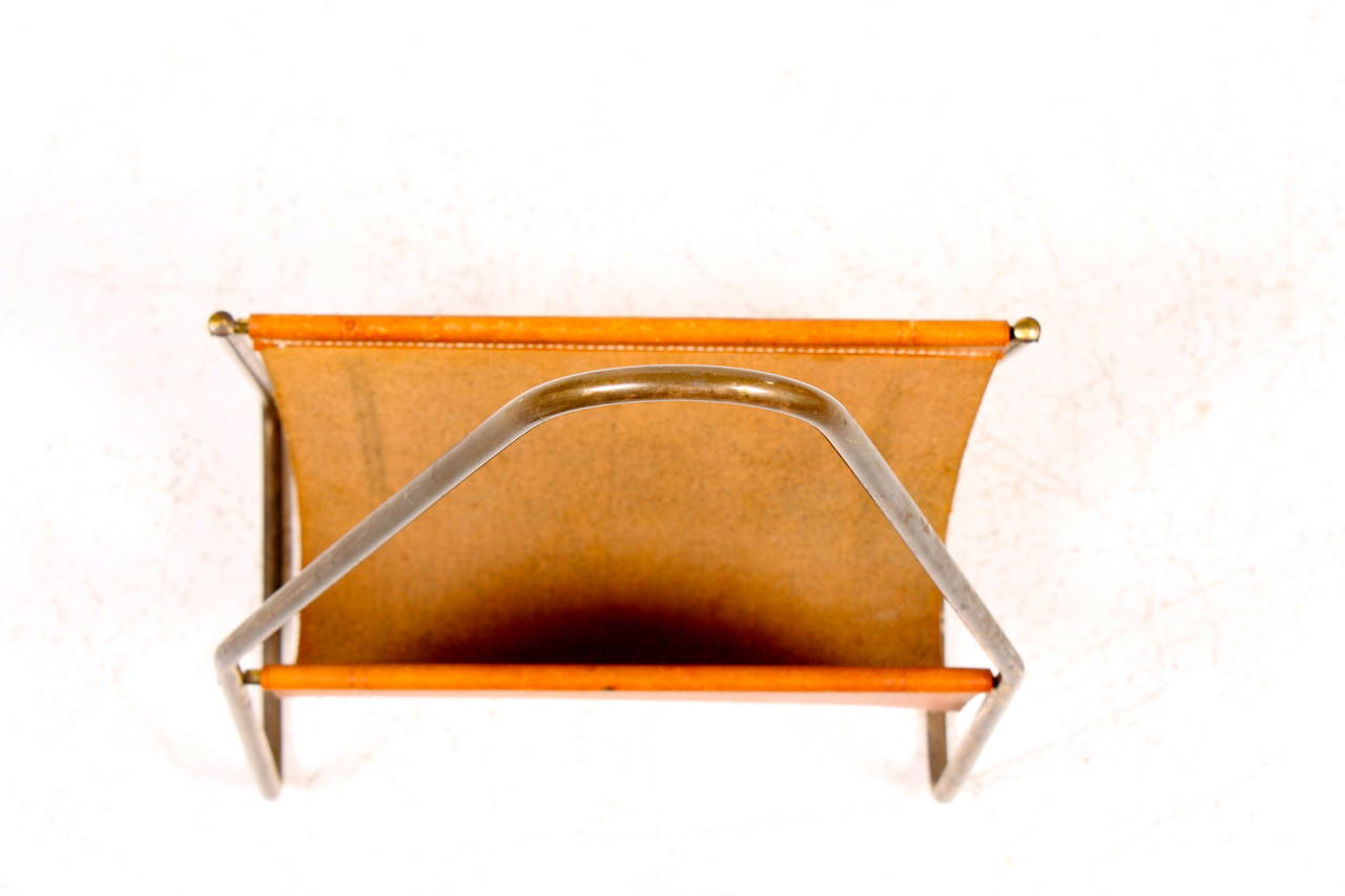 Magazine stand in brass and leather designed and made by Carl Auböck in the 1950s. Great condition.