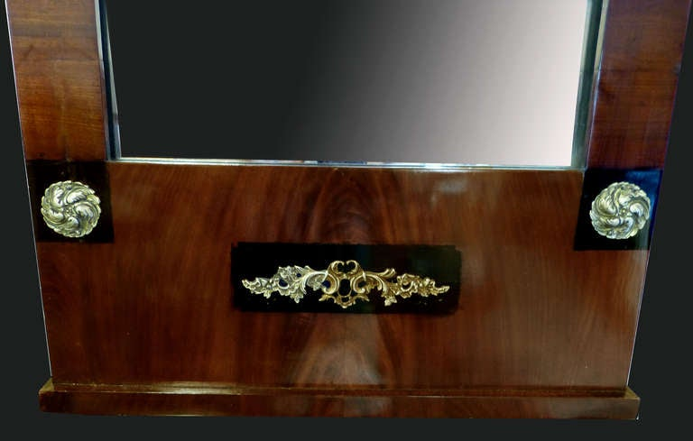Austrian Mirror of Early 19th Century Biedermeier Period with Empire Ornaments For Sale