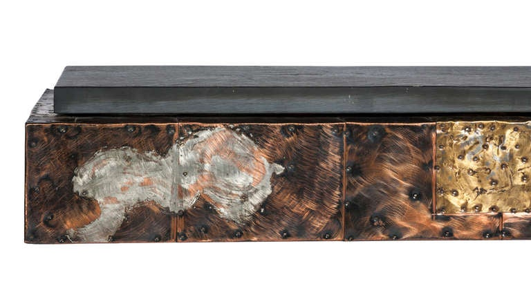Stunning 1970s Paul Evans for Directional patchwork console and mirror. Each piece is clad in nailed-on patinated copper, brass and pewter panels arranged in a patchwork pattern. The wall-mounted console features a thick, natural cleft slate top and