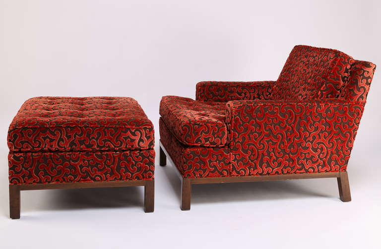 Stunning. Deep and comfortable lounge chair and ottoman by Harvey Probber, circa 1960s. Pristine original upholstery with raised red velvet pattern on a flat brown woven background. Harvey Probber label on seat. Chair, 32-1/2
