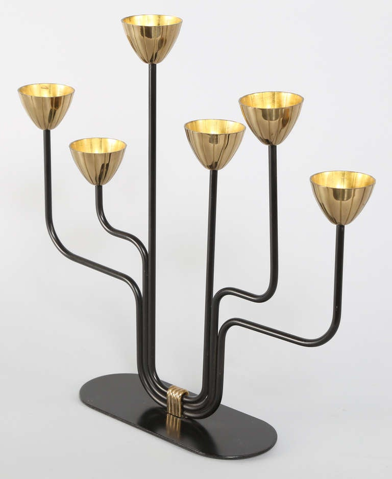 Elegant 1960s brass and enameled metal candelabra designed by Gunnar Andersen for Ystad Metal, Sweden. Marked.   See this item in our Brooklyn showroom, 61 Greenpoint Ave., Suite 312, Brooklyn, 11 a.m. to 5 p.m. Tuesday through Friday and by